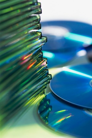 Compact Discs and Stack of Jewel Cases